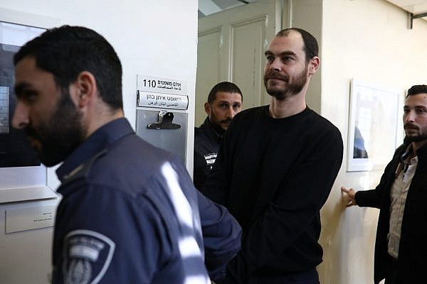 Israeli activist Jonathan Pollak at the Tel Aviv Magistrates' Court, arrested as part of an unprecedented private suit by Israeli right-wing group Ad Kan, Jan. 15, 2020. (Oren Ziv)