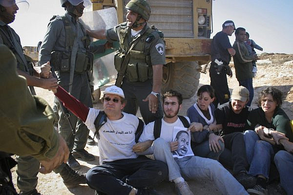 Israeli soldiers remove Israeli activists who stage a sit-in on the route of the separation wall in the West Bank village of Bil'in, West Bank, November 11, 2005. (Oren Ziv/Activestills.org)