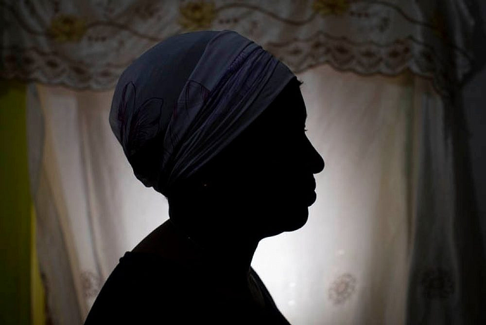 """Binto, a survivor of FGM who was granted asylum in Israel, in her home. """"I want them to stop doing this to girls everywhere. All women should be free and have control over their own bodies."""" (Oren Ziv)"""