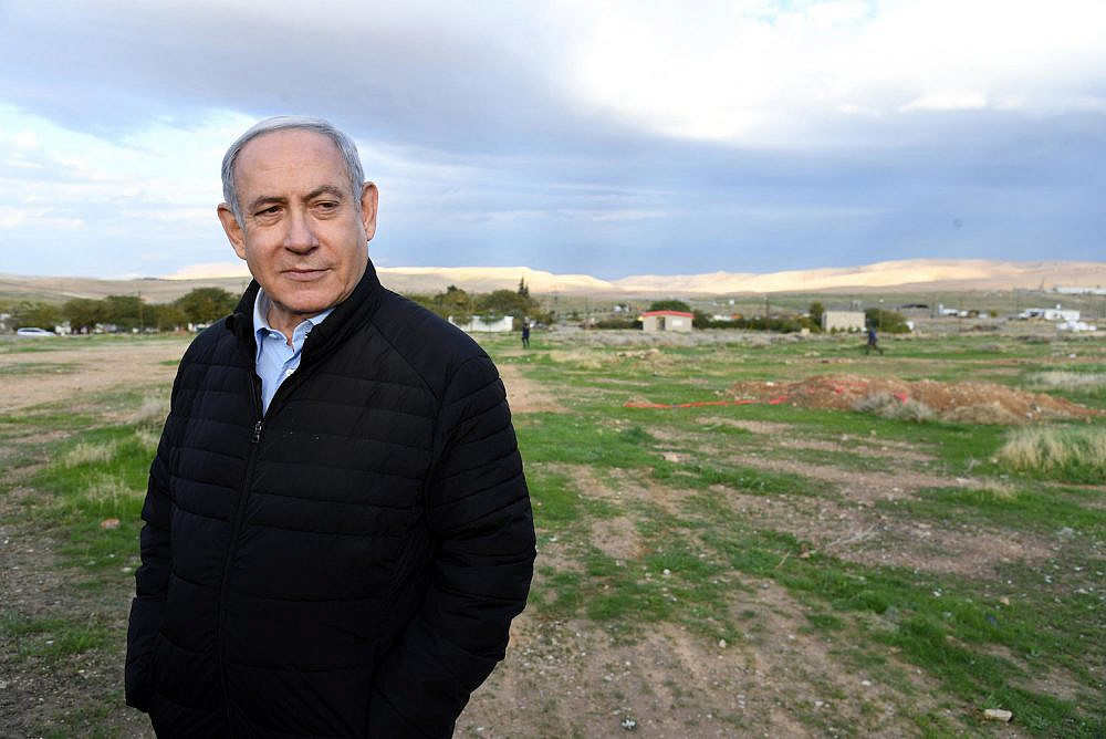 Prime Minister Netanyahu attends a planting ceremony for the Jewish holiday of Tu B'Shevat in the West Bank settlement of Mevo'ot Yericho, February 10, 2020. (Haim Zach/GPO)