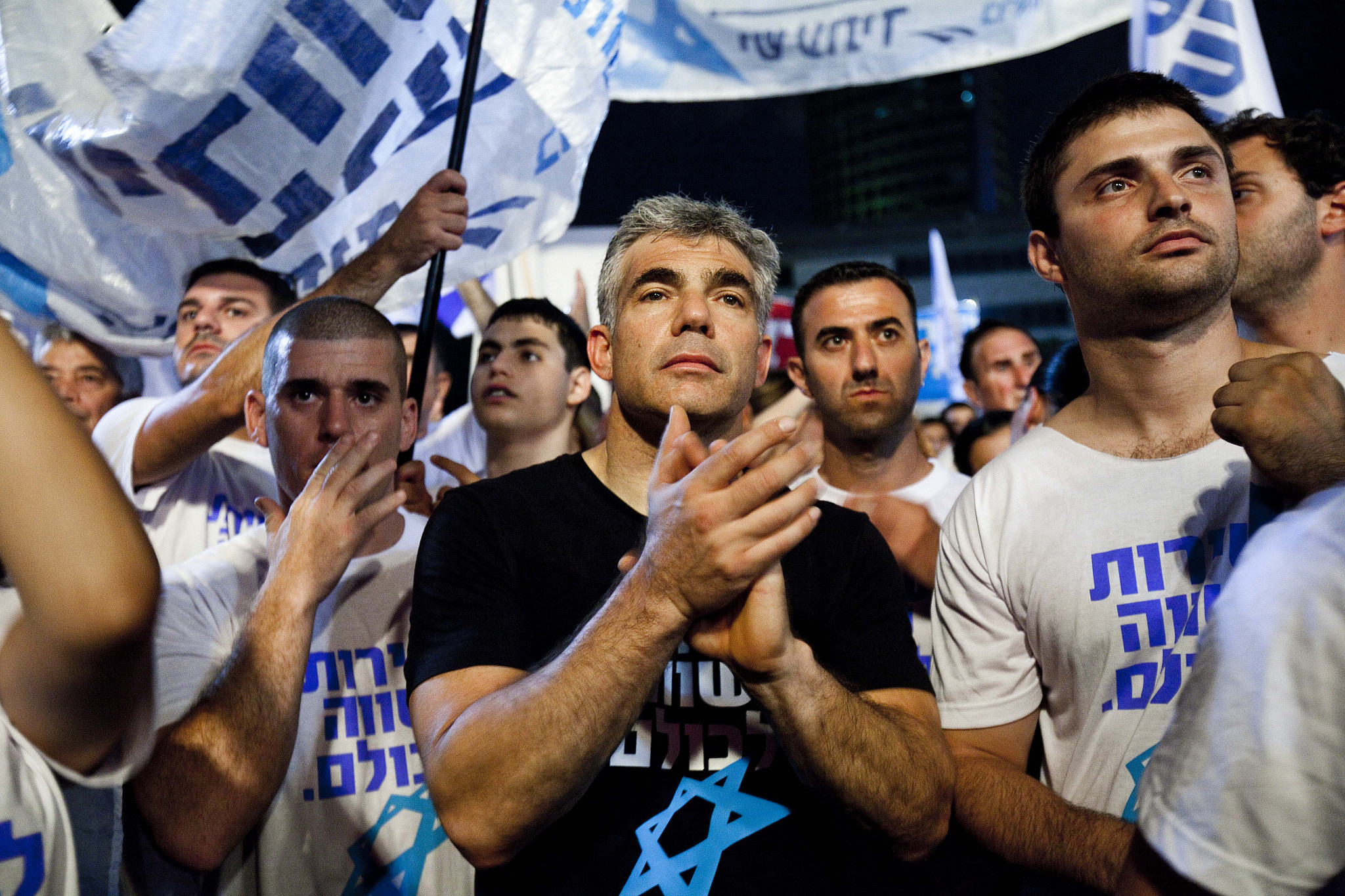 Yair Lapid and some 25,000 people hold a mass rally in Tel Aviv urging the government to enact universal draft legislation, July 7, 2012. (Tali Mayer/Flash90)