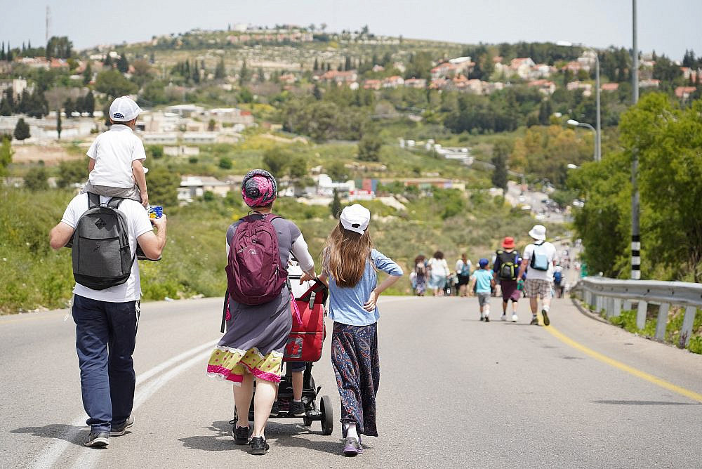 Jewish Israeli settlers marching near the settlement of Kedumim in the occupied West Bank, on April 25, 2019. (Hillel Maeir/Flash90)