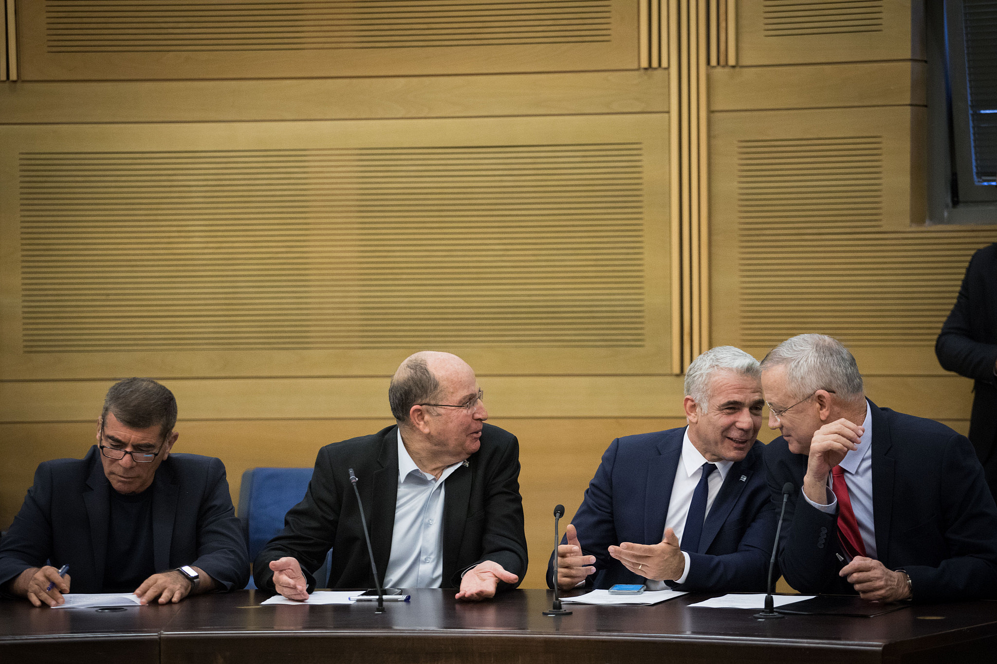 Benny Gantz, Yair Lapid, Moshe Yaalon and Gaby Ashkenazi of the Blue and White party, during a faction meeting at the Knesset in Jerusalem, on December 9, 2019. (Hadas Parush/Flash90)