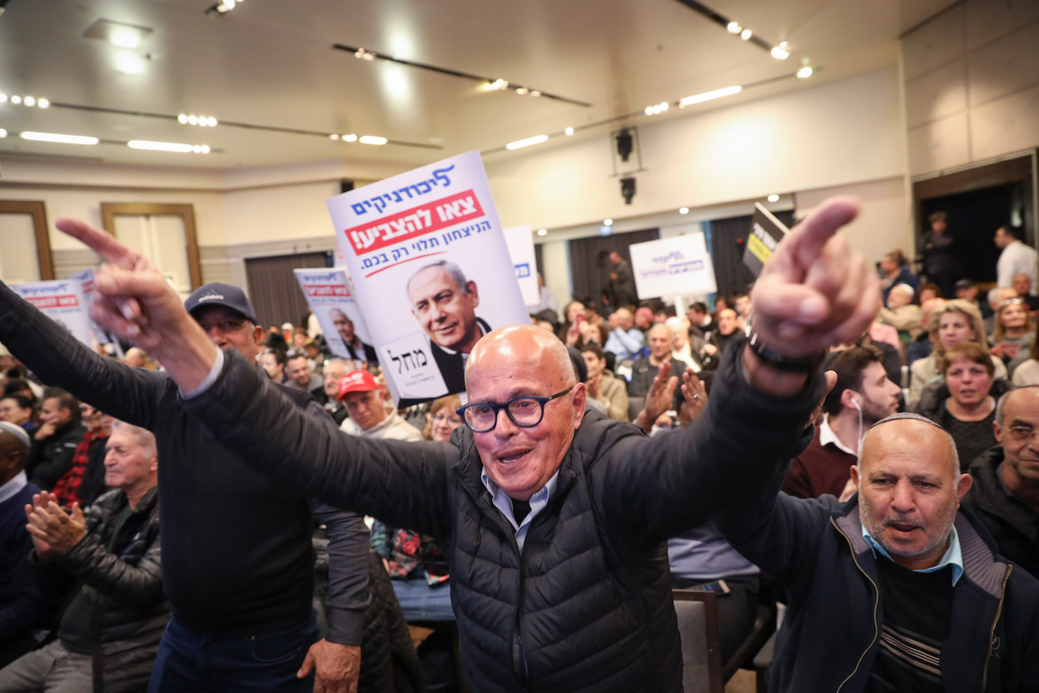 Likud supporters seen at a party rally in Jerusalem ahead of the Israeli general elections, February 26, 2020. (Olivier Fitoussi/Flash90)