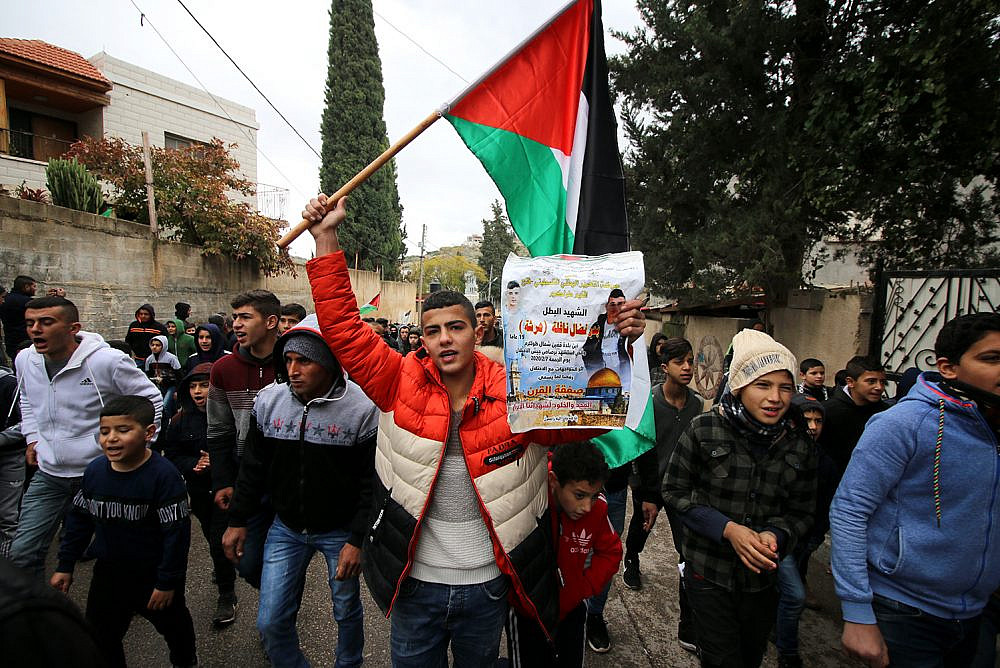 Palestinians attend the funeral of Badr Nafla, who was shot dead by Israeli troops on February 7, Kafr Qaffin, February 8, 2020. (Ahmad al-Bazz/Activestills.org)