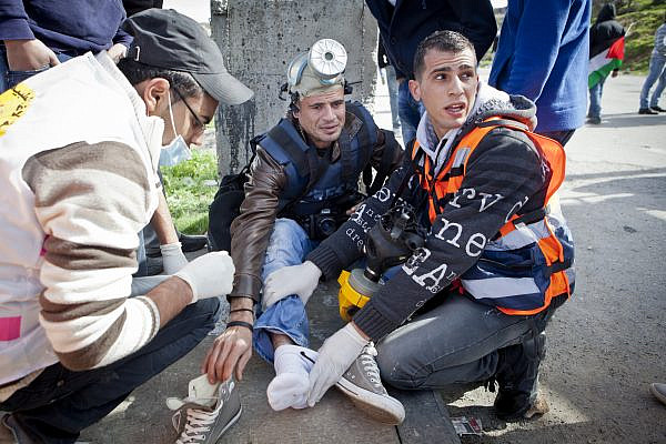 Illustrative photo of Palestinian photojournalist injured during protests between Beitunia and Ofer prison in the West Bank, Feb 15, 2013. (Mati Milstein)