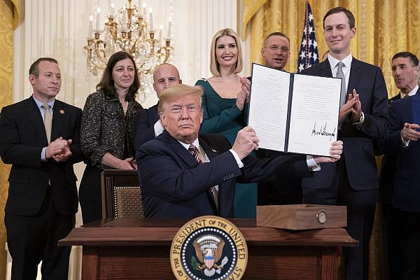 President Trump displays the controversial Executive Order on Combating anti-Semitism during an afternoon Hanukkah reception alongside members of his administration, including son-in-law Jared Kushner, in the White House, December 11, 2019. (Joyce N. Boghosian/White House Photo)
