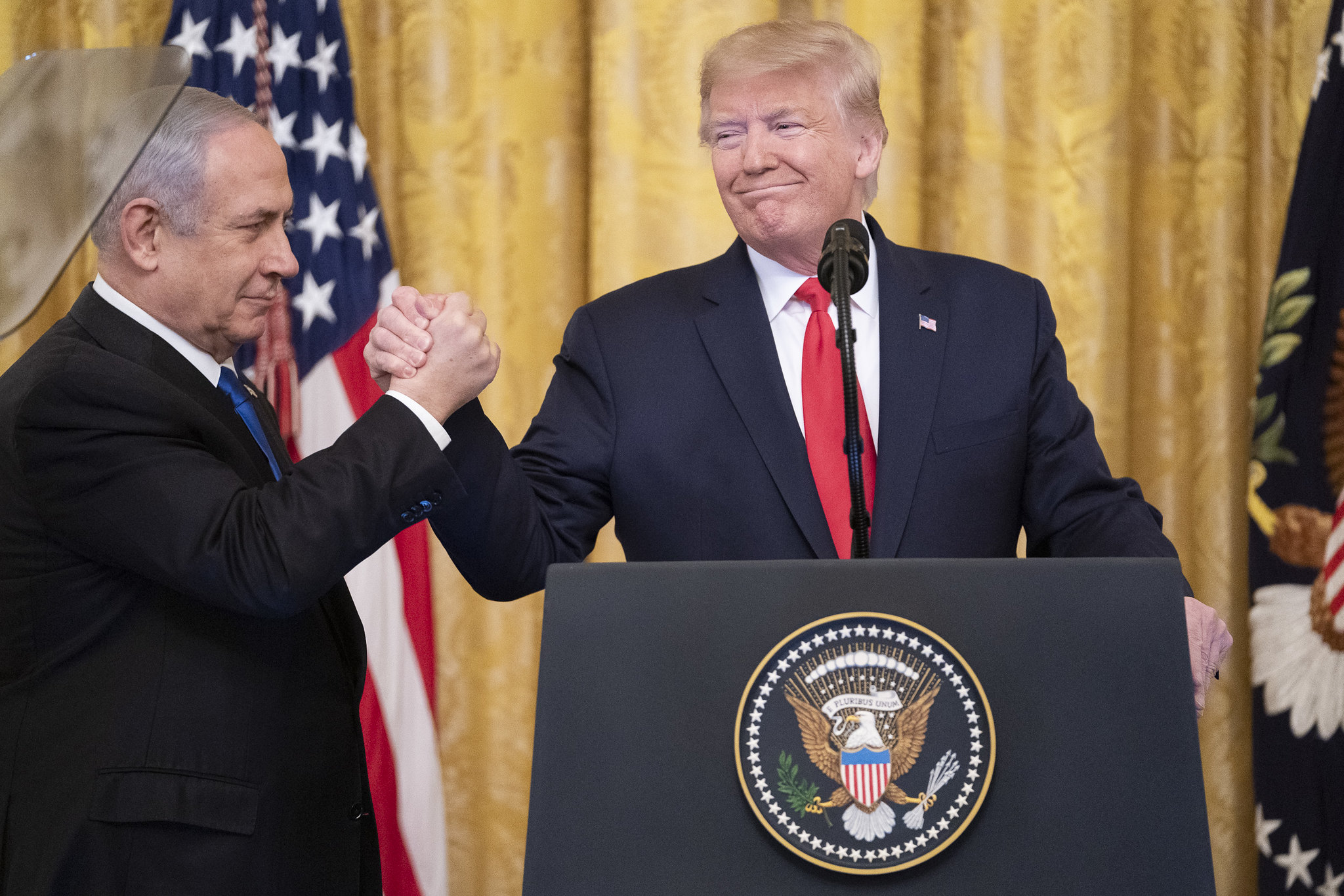 U.S. President Donald Trump delivers remarks with Israeli Prime Minister Benjamin Netanyahu Tuesday, Jan. 28, 2020, in the East Room of the White House to unveil details of the Trump administration's Middle East plan. (Shealah Craighead/White House)