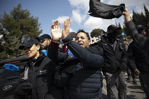 Israeli police arrest a protester near the Knesset in Jerusalem during a protest against the shutdown of the Israeli parliament, March 19, 2020. (Oren Ziv)