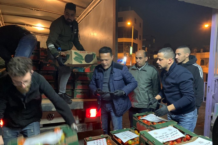 Residents of Palestinian villages preparing to send food to Bethlehem in coordination with volunteers from the Relief Committee, during the city's lockdown over the coronavirus (Courtesy of the Relief Committee)