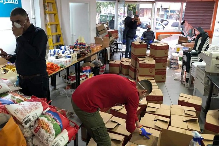 Volunteers in Haifa preparing food boxes for the elderly and families in need. (Courtesy of Bilal Alhousari