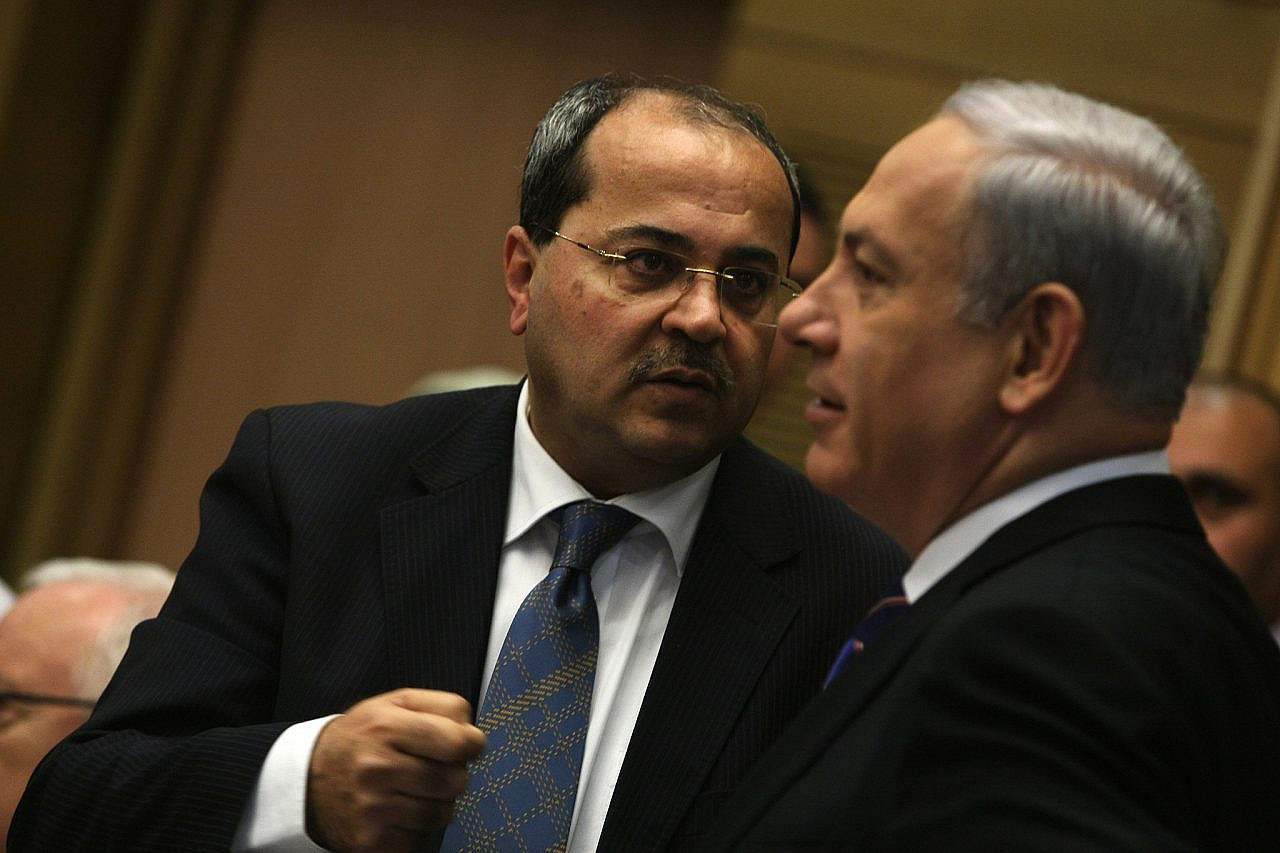 MK Ahmad Tibi speaks with Prime Minister Benjamin Netanyahu during a session of a parliamentary committee of inquiry devoted to the problem of rampant violence in the Palestinian community in Israel at the Knesset in Jerusalem, February 13, 2012. (Kobi Gideon/Flash90)