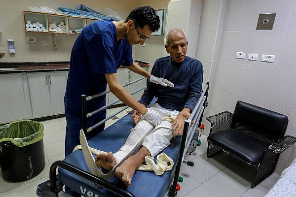 A Palestinian man wounded by an Israeli airstrike arrives at the Nasser hospital in Khan Younis in the southern Gaza Strip, on July 14, 2018. (Abed Rahim Khatib/Flash90)