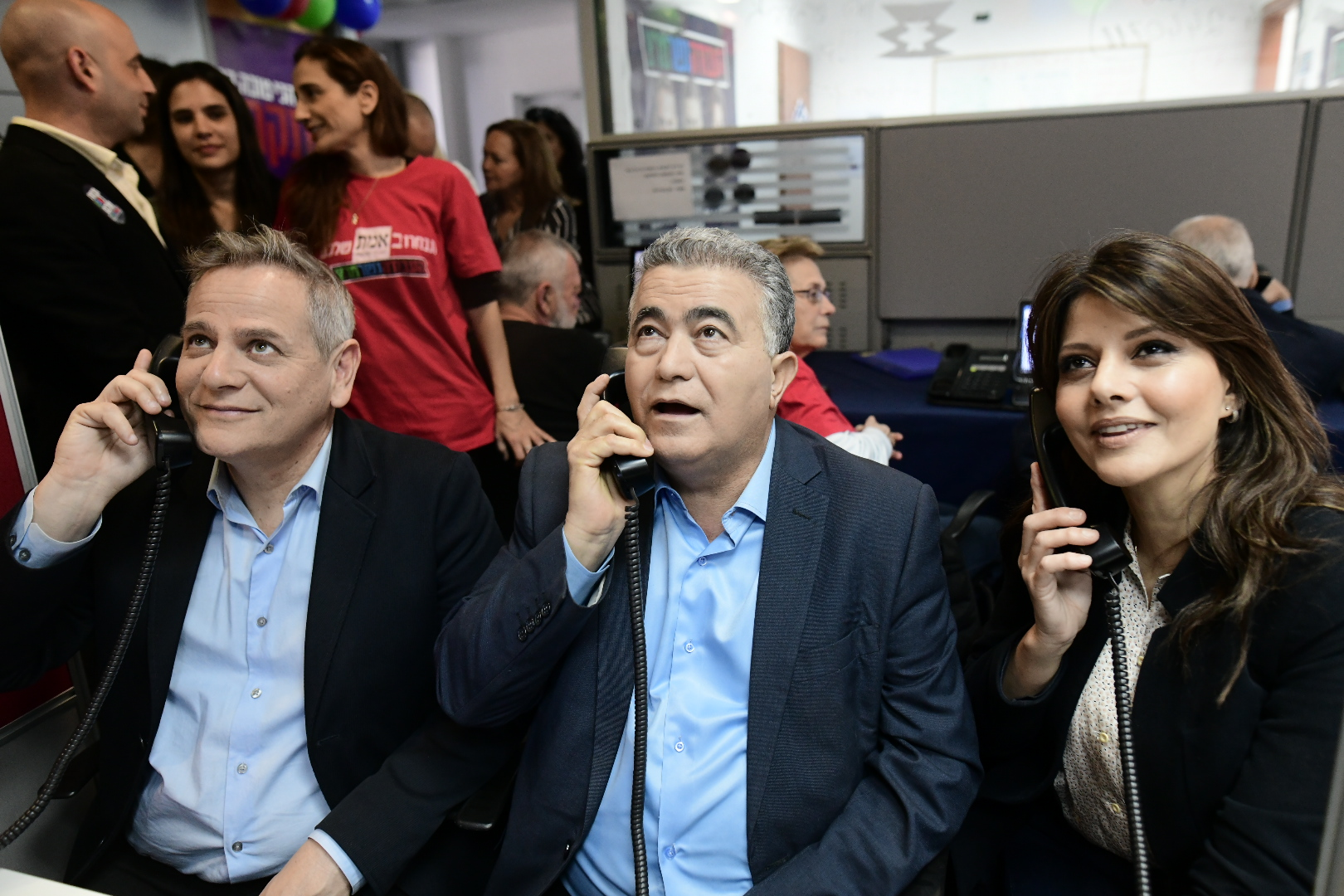 The heads of the Labor-Gesher-Meretz party, Nitzan Horowitz, Amir Peretz, and Orly Levy, make calls to convince citizens to vote for them at their election headquarter in Tel Aviv on March 01, 2020. (Tomer Neuberg/Flash90)