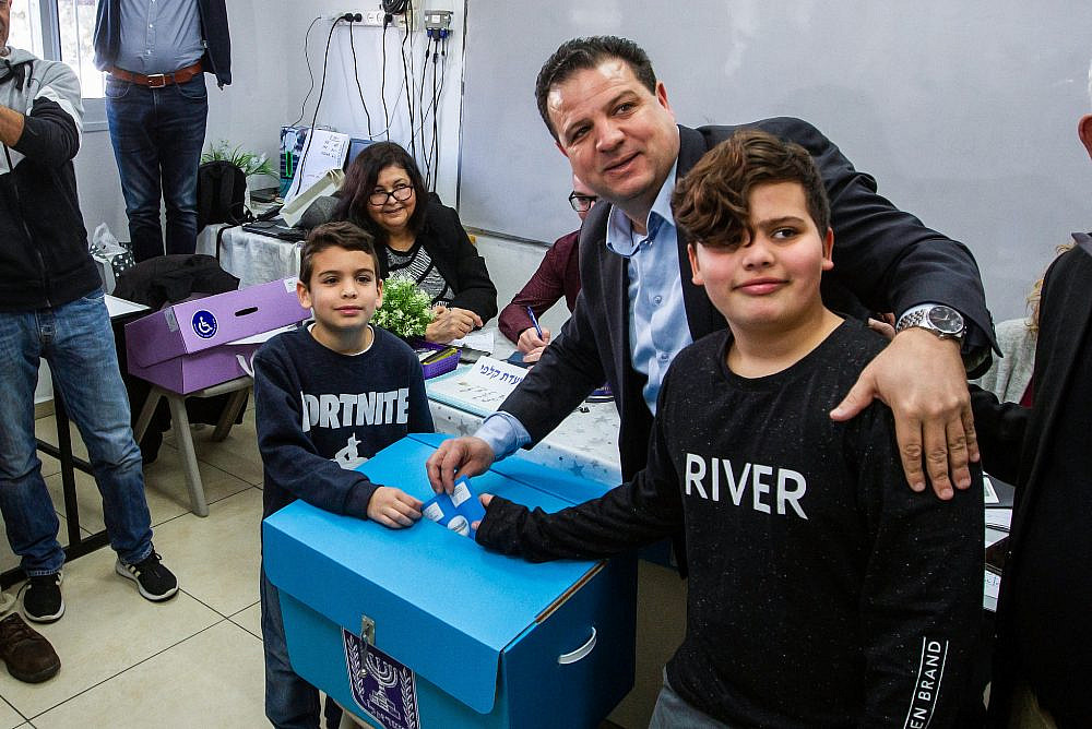 Joint List chairperson Ayman Odeh casts his ballot at a voting station in Haifa, during the Knesset Elections, on March 2, 2020. (Flash90)