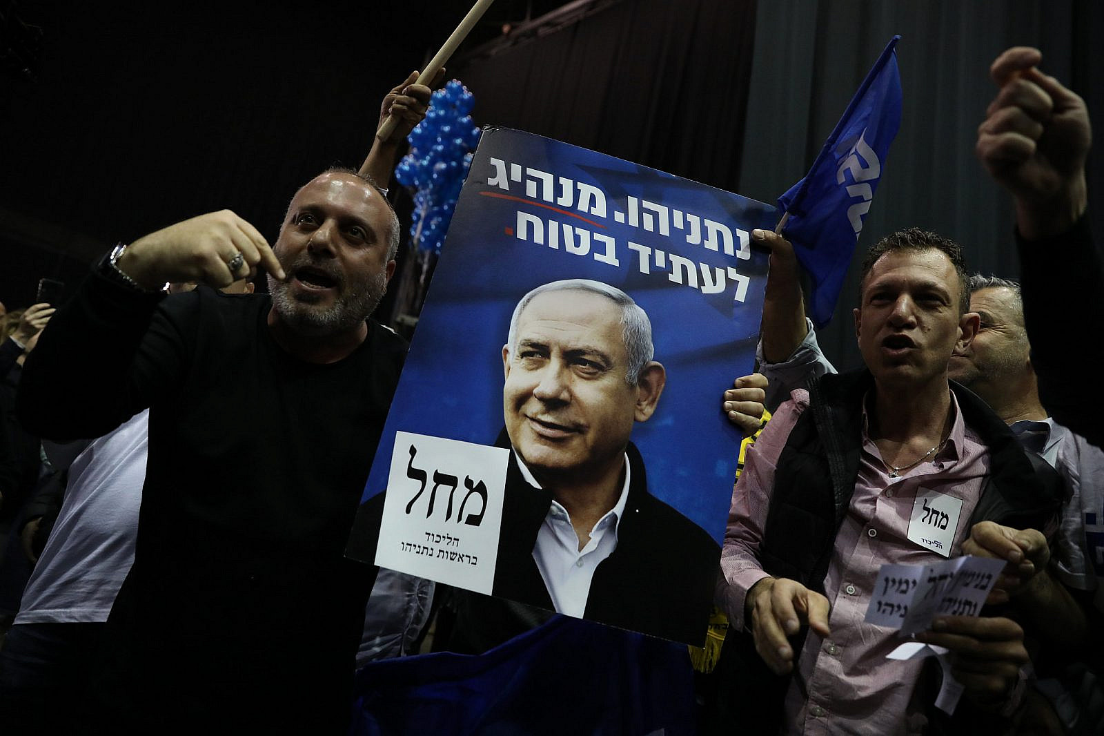 Likud supporters react to the results of the demo polls at the Likud headquarters on elections night in Tel Aviv, March 2, 2020. (Olivier Fitoussi/Flash90)