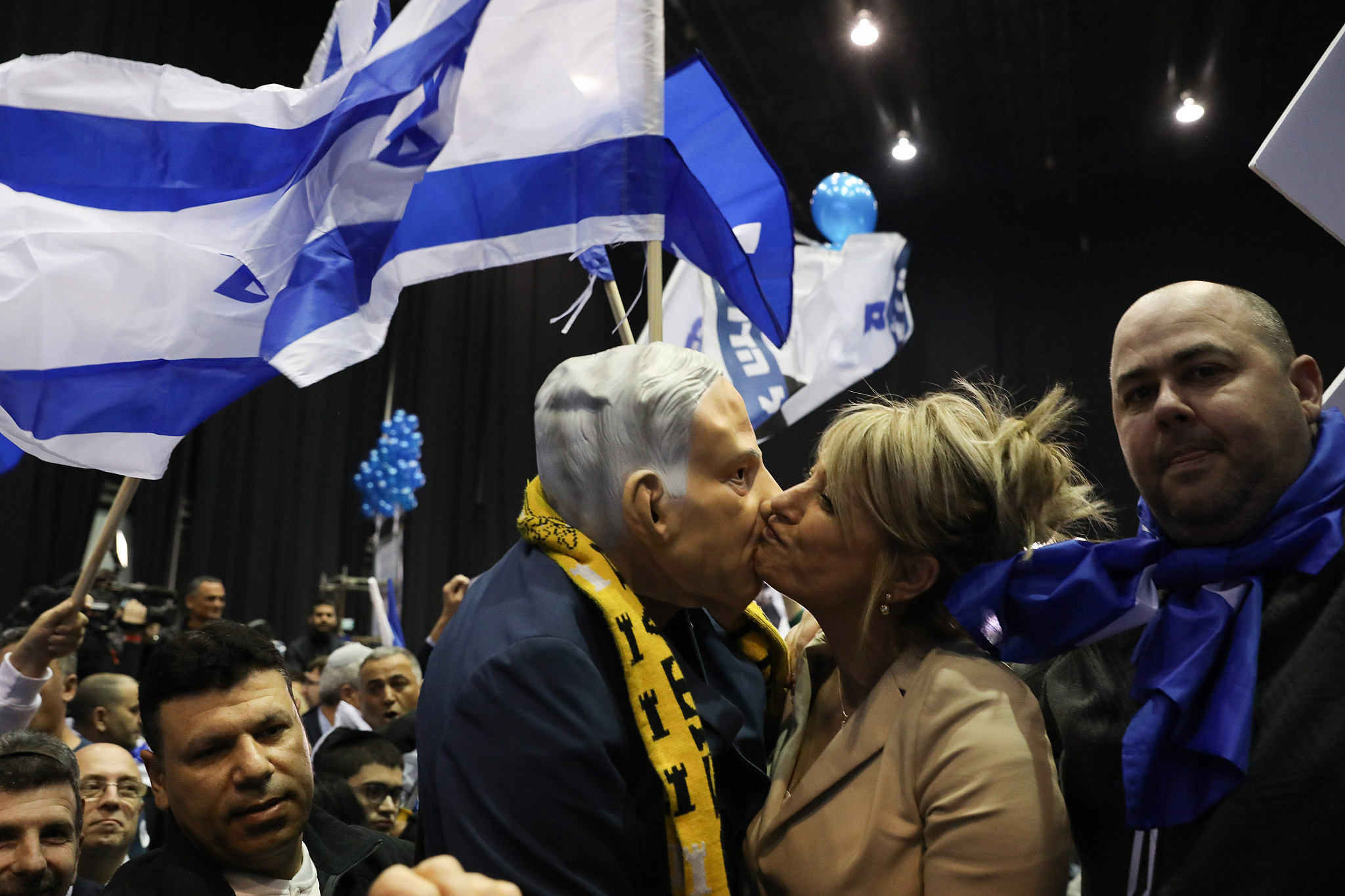 Likud supporters react to exit polls at the Likud headquarters on elections night in Tel Aviv, March 2, 2020. (Olivier Fitoussi/Flash90)