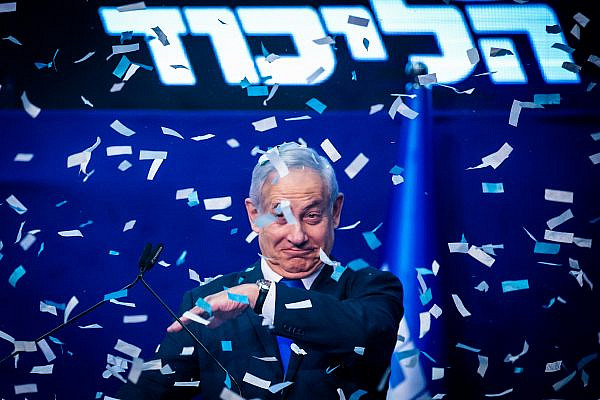 Prime Minister Benjamin Netanyahu and his wife Sara address their supporters on the night of the Israeli elections, at the party headquarters in Tel Aviv, March 3, 2020. (Olivier Fitoussi/Flash90)