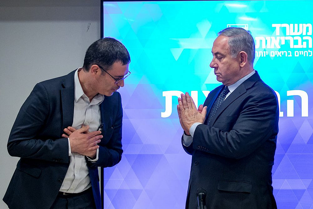 Israeli prime minister Benjamin Netanyahu and Director General of the Ministry of Health Moshe Bar Siman Tov hold a press conference about the coronavirus COVID-19, at the Ministry of Health in Jerusalem, on March 4, 2020. (Olivier Fitoussi/Flash90)