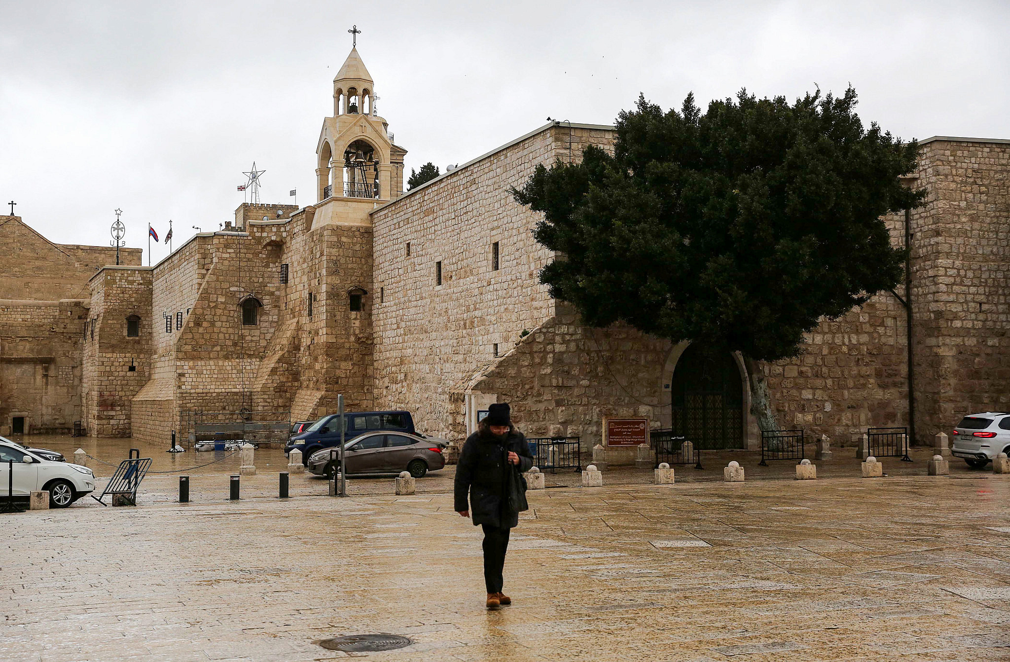 Palestinians walk outside the closed Church of the Nativity in the West Bank city of Bethlehem, March 5, 2020. (Wisam Hashlamoun/Flash90)