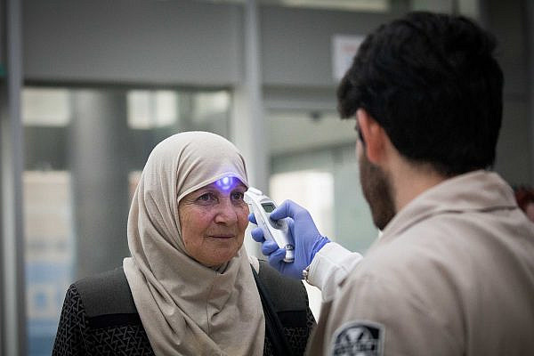 A woman having a fever test as she enters the Hadassah Ein Karem hospital, Jerusalem, September 3, 2017. (Yonatan Sindel/Flash90)
