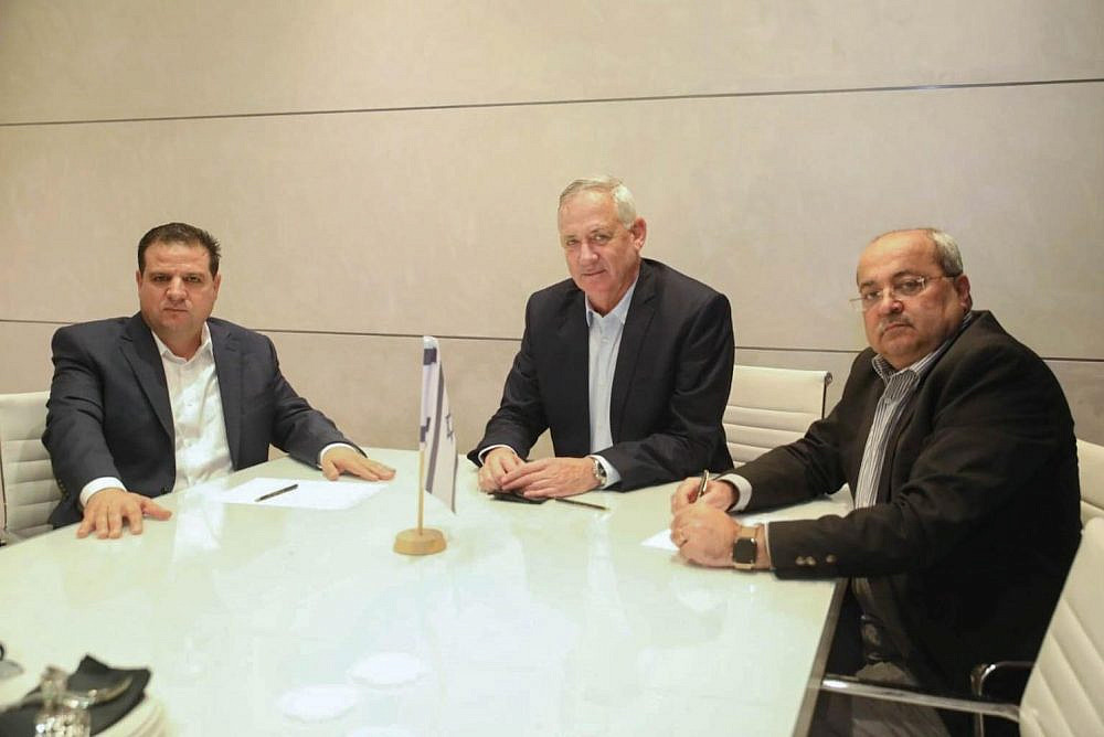 Blue and White Chairman Benny Gantz (center) meets with Joint List Chairman Ayman Odeh (left) and Joint List MK Ahmad Tibi to discuss the possibility of establishing a minority government backed by Israel's Palestinian-led parties, October 19, 2019. (Ofek Avshalom)