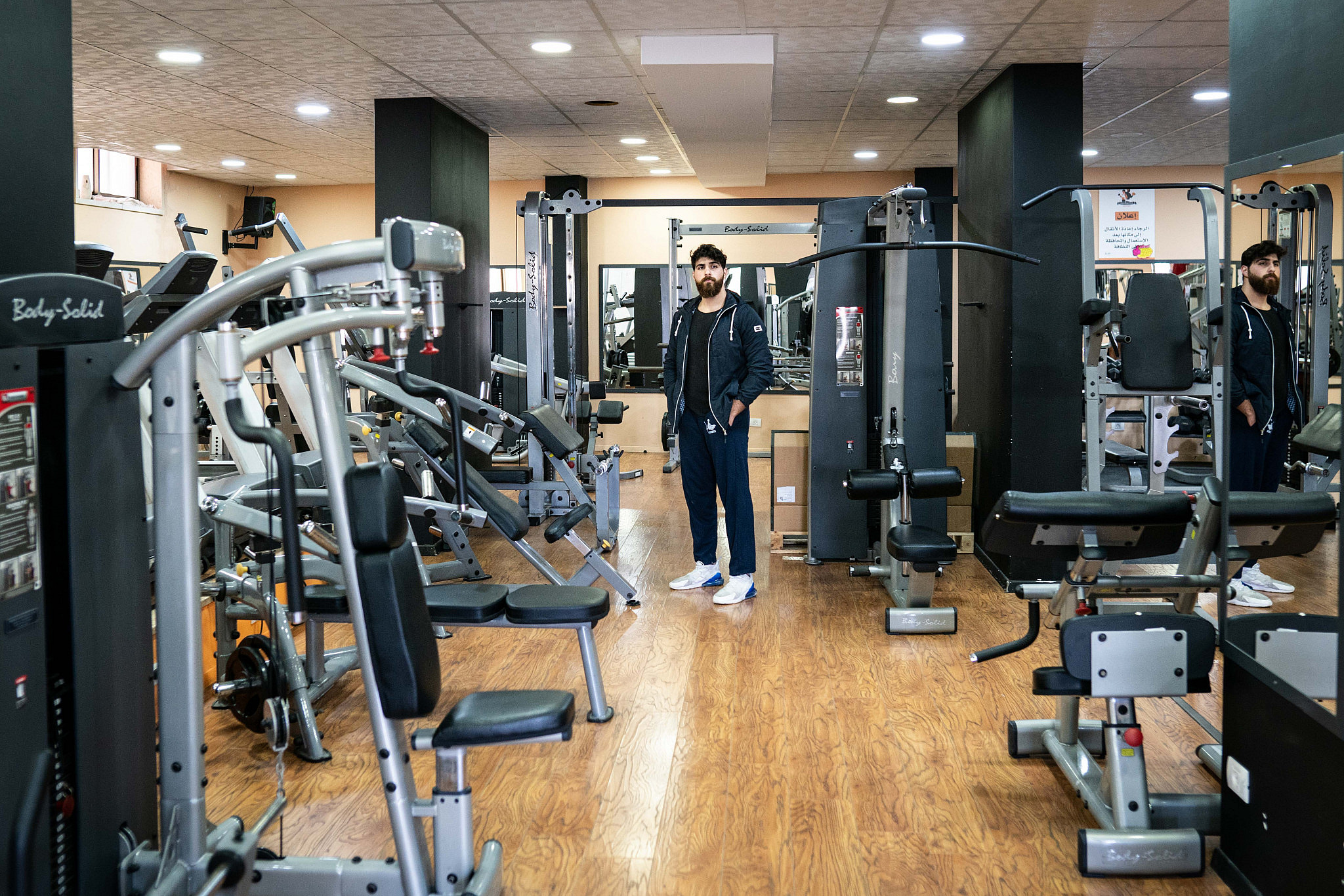Nicholas Zeidan, a personal trainer, stands at his family's empty gym in Bethlehem, on March 10, 2020. (Samar Hazboun)