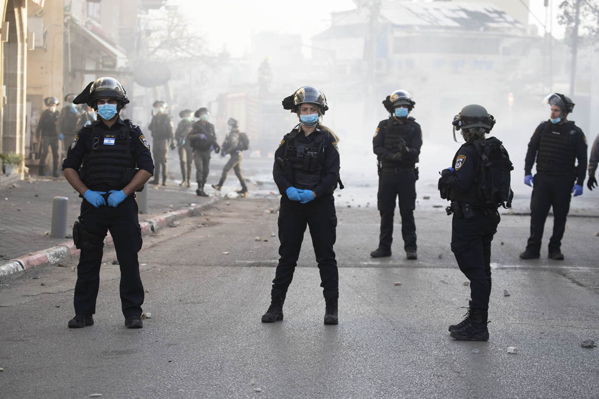 Israeli police officers in Jaffa, April 1, 2020. Protests erupted in the city after police arrested four citizens and wounded a woman when a teenager failed to identify. (Oren Ziv)