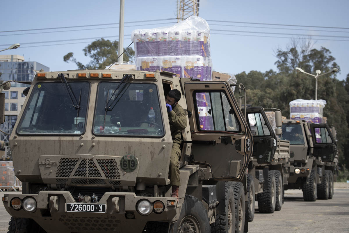 A Israeli army vehicle on its way to deliver toilet paper and food to families and elderly citizens in need, Bnei Brak, April 7, 2020. (Oren Ziv)