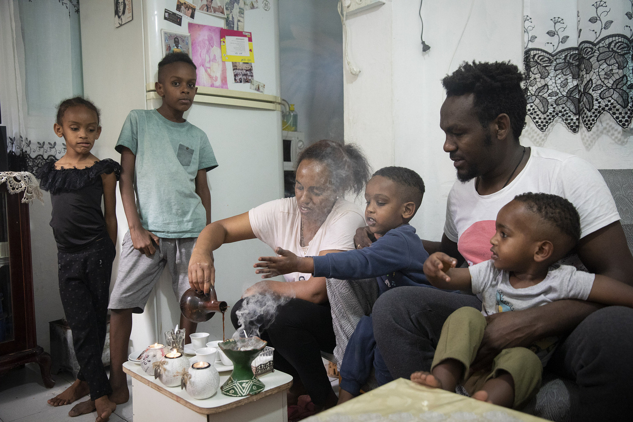 Afwerkei (33), Tsaga (31), and their children Abraham (8), Jerusalem (6), Farzagi (3) and Surrey (2) have been in Israel for 10 years. Prior to the crisis, Afwerkei worked in construction and in a store, while Tsaga worked at a kindergarten. Now they are both unemployed. They live in a studio apartment in south Tel Aviv. (Oren Ziv)