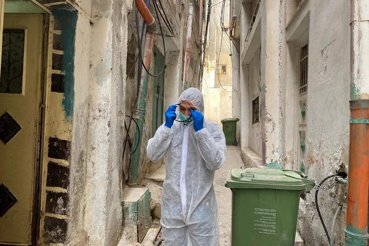 A volunteer seen walking in the alleyways of Shuafat Refugee Camp. (Kamel Ja'abri)