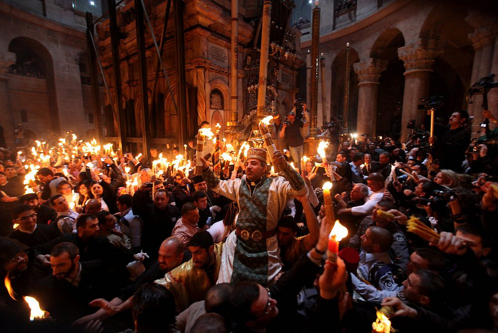 Orthodox Christian worshippers take part in the Holy Fire ceremony at the Church of the Holy Sepulchre in Jerusalem's Old City during the Easter holiday, April 23, 2011. (Kobi Gideon /Flash90)