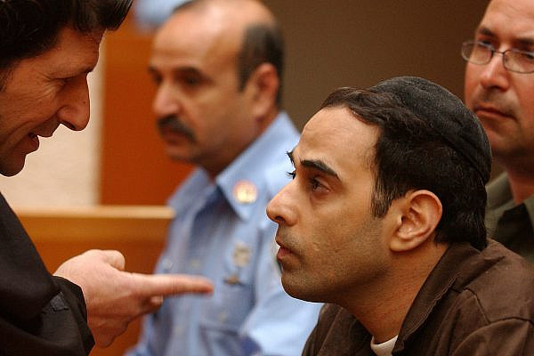 Yigal Amir, who was charged with the murder of Israeli Prime Minister Yitzhak Rabin, speaks with his lawyer Shmuel Casper at the Supreme Court in Jerusalem on March 07, 2005. (Flash90)