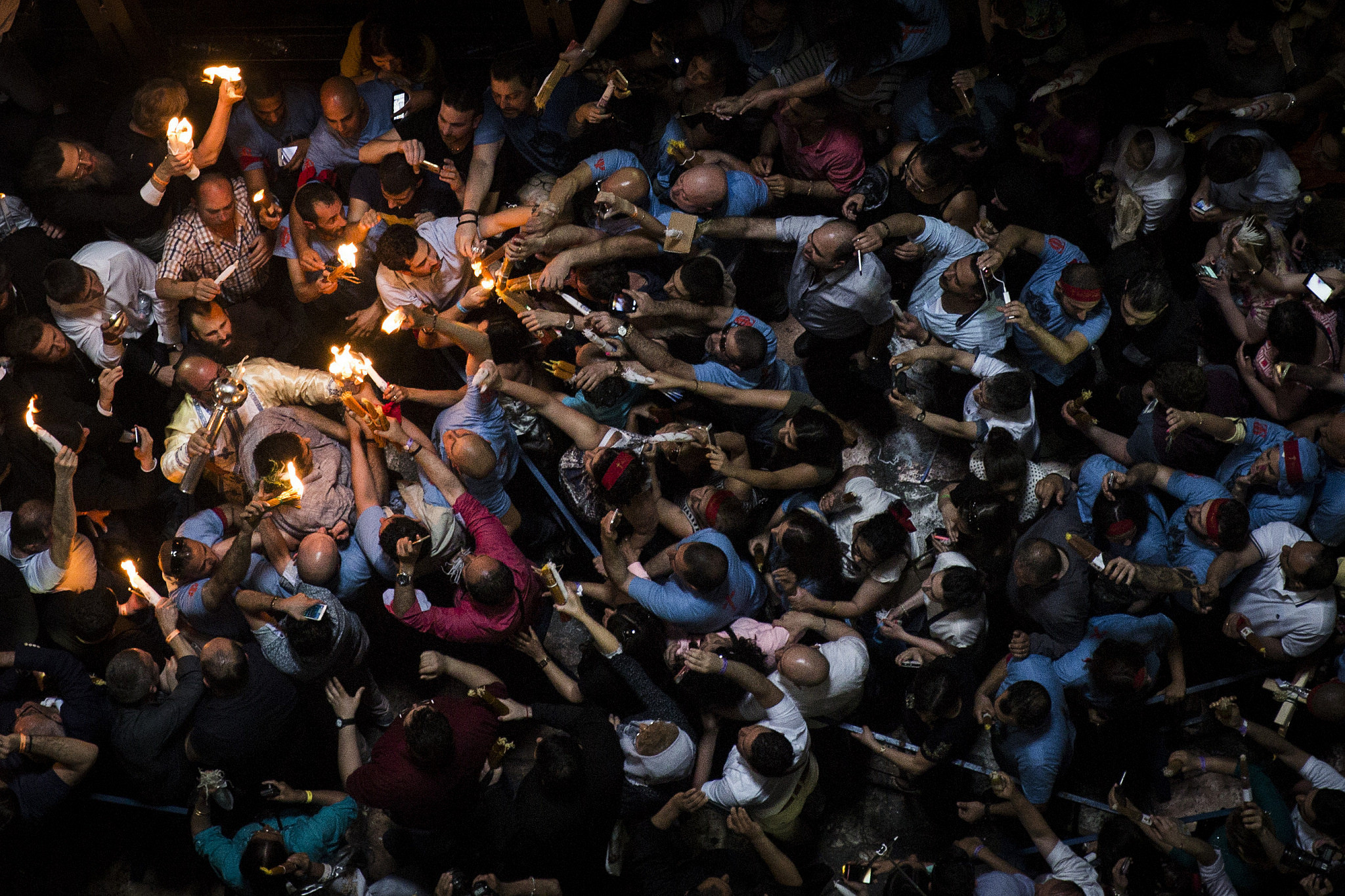 Orthodox Christian worshippers take part in the Holy Fire ceremony at the Church of the Holy Sepulchre in Jerusalem's Old City during the Easter holiday, April 30, 2016. (Hadas Parush/Flash90)
