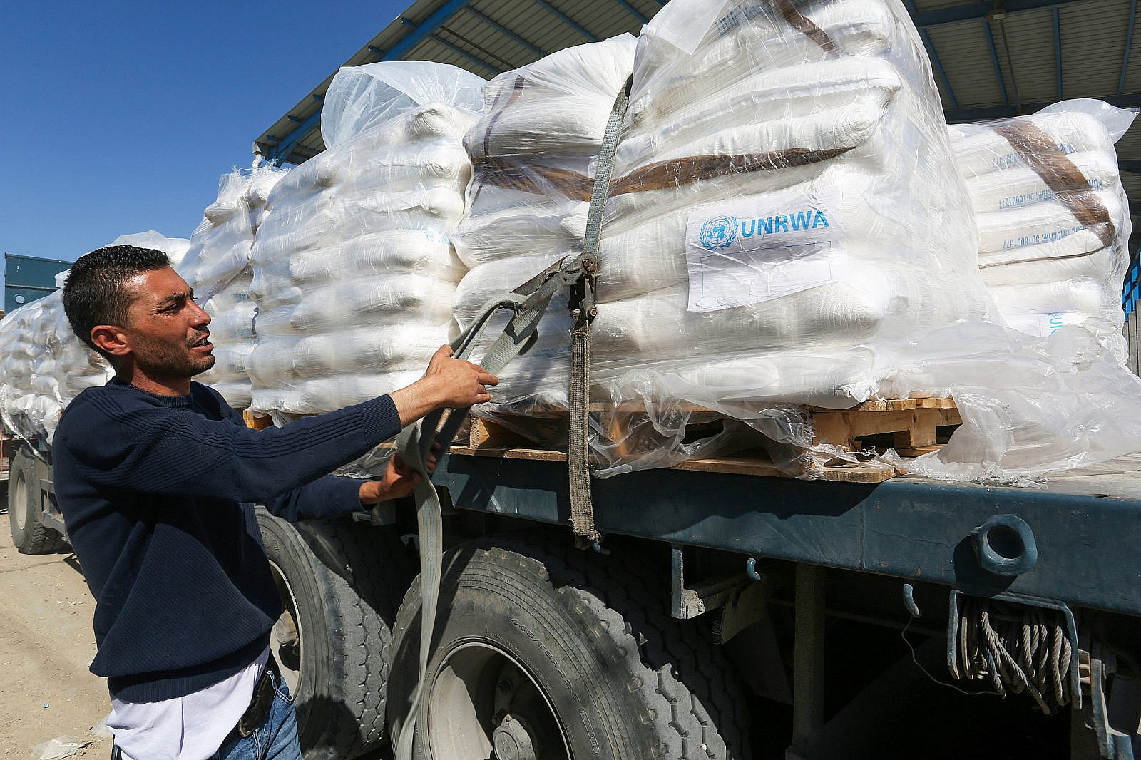 Trucks loaded with goods enter the Gaza Strip from the Kerem Shalom crossing, the only crossing between the Gaza Strip and Israel entering aid and goods, in Rafah in the southern Gaza Strip, on May 12, 2019. (Abed Rahim Khatib/Flash90)