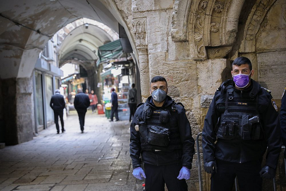 Israeli border police wear face masks as protection from the coronavirus as they stand guard in the Muslim quarters in Jerusalem's Old City. March 15, 2020. (Yossi Zamiri/Flash90)