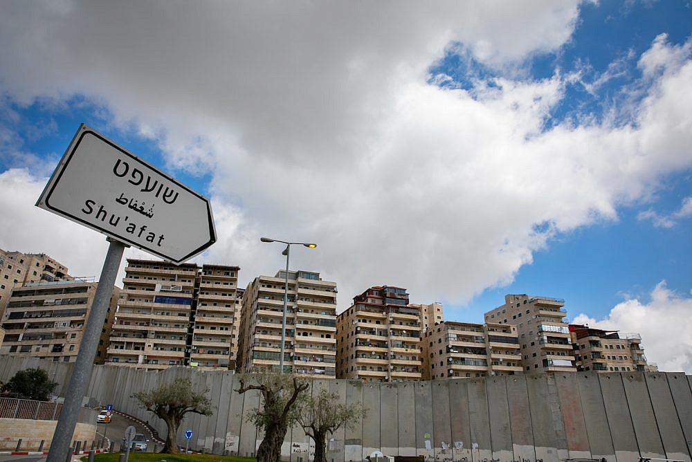 A view of the separation wall and Shuafat Refugee Camp, Jerusalem, March 22, 2020. (Photo By Olivier Fitoussi/Flash90)