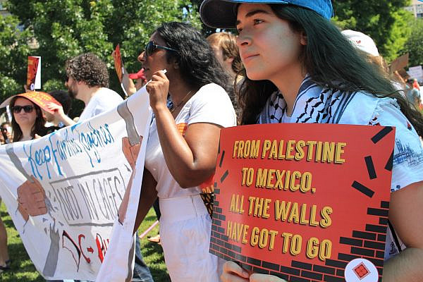 Activists with the U.S. Campaign for Palestinian Rights participate in a protest. (Courtesy of USCPR)