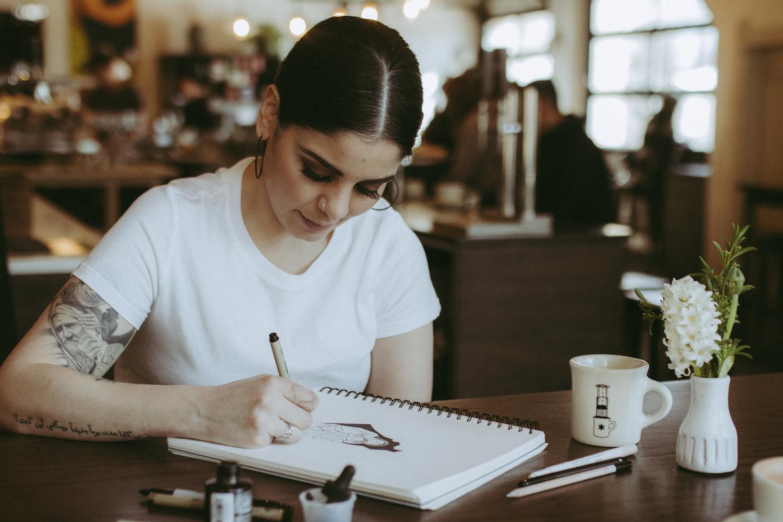 Mary Hazboun drawing at a cafe in Chicago, Illinois, February 16, 2020. (Photo: Tamara Hijazi)