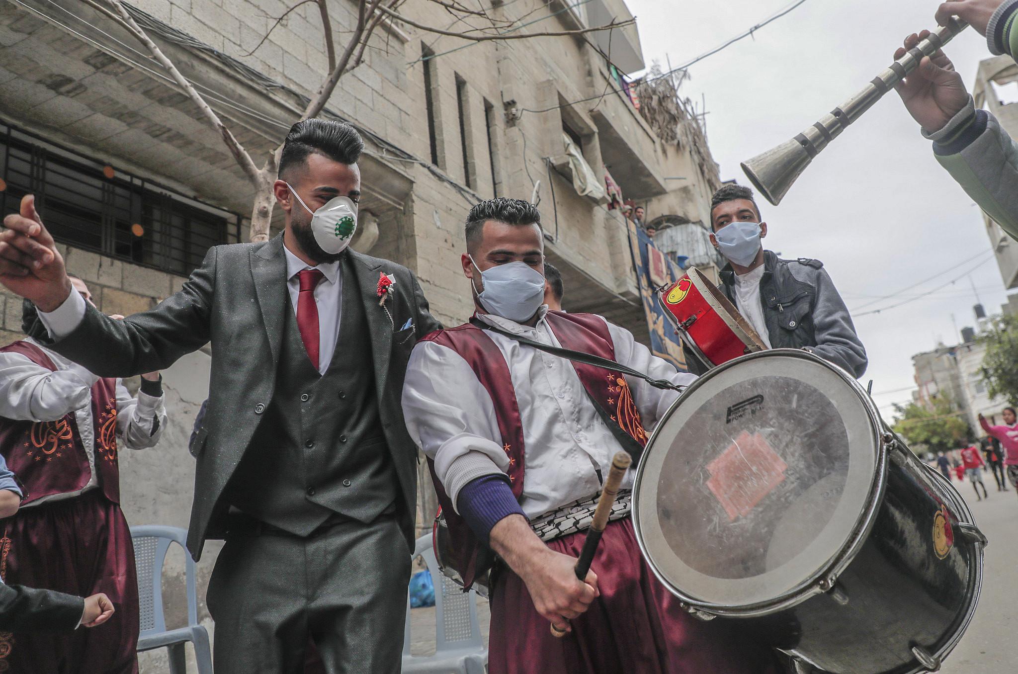 The groom Ali Abu Seif on the day of his wedding under quarantine, Gaza City, April 10, 2020. (Mohammed Zaanoun)