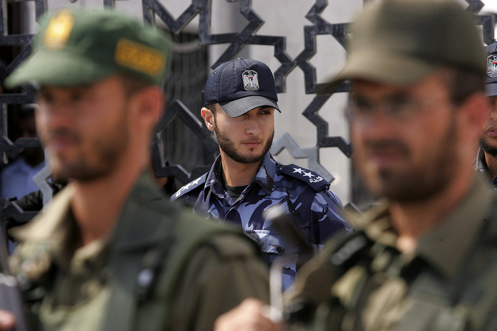 Members of Hamas' security forces stand guard in front of the Rafah border crossing in the southern Gaza Strip on September 16, 2013. (Abed Rahim Khatib/Flash90)