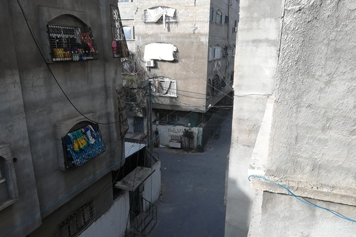 The crowded alleyways of the refugee camp Sana lives in.