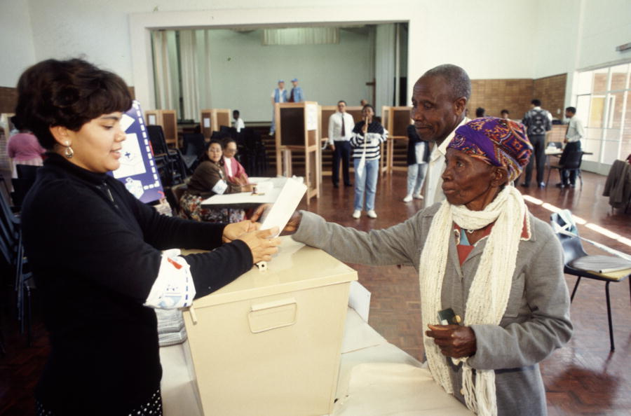 A voter casts her ballot in a polling station in Edendale Township in Pietermaritz. April 1, 1994. (UN Photo/Chris Sattlberger)