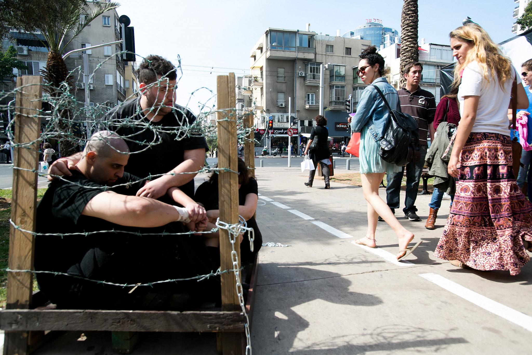 Israeli animal rights activists protest in central Tel Aviv, March 21, 2013. (Yotam Ronen/Activestills.org)