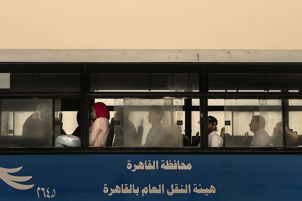 Egyptians seen on a public bus in Cairo during the coronavirus pandemic, April 6, 2020. (Mohamed Hozyen)