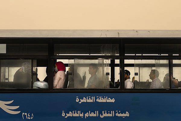 Egyptians seen on a public bus in Cairo during the coronavirus pandemic, April 6, 2020. (Mohamed Hozyen)