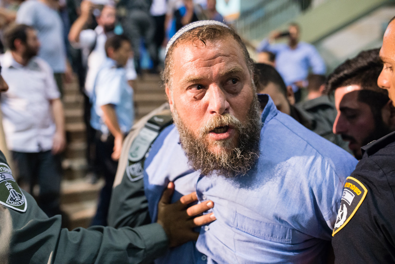 Far-right leader Benzi Gopstein seen arrested by Israeli police outside a Christian event in Jerusalem, September 22, 2016. (Dor Kedmi/Flash90)