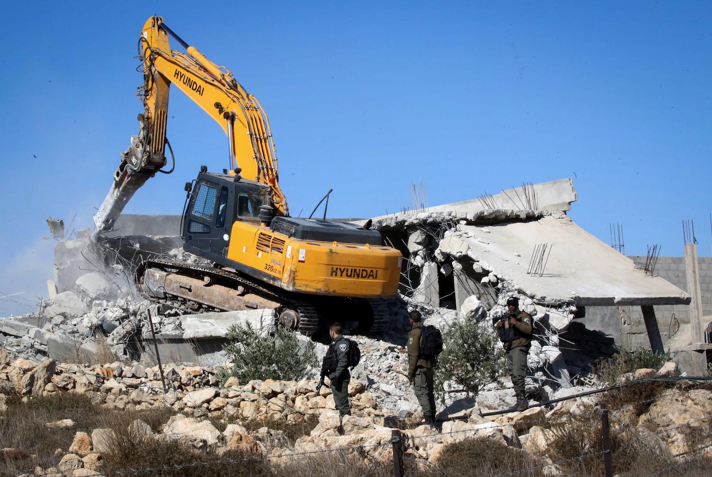 An Israeli bulldozer demolishes a Palestinian house near Hebron in the West Bank on November 19, 2019. (Wisam Hashlamoun/Flash90)