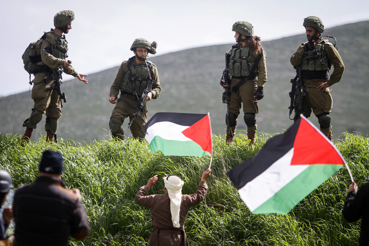 Israeli security forces clash with Palestinian demonstrators protesting President Trump's Middle East peace plan, near a settlement Beqa'ot, Jordan Valley, West Bank, February 29, 2020. (Nasser Ishtayeh/Flash90)