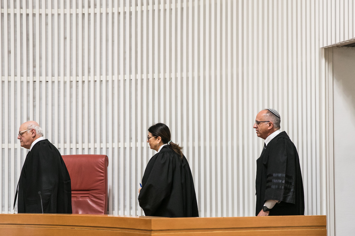 Supreme Court Chief Justice Esther Hayut and other justices arrive at a court hearing on the decision to allow the Shin Bet to track cellphone location data to help combat the coronavirus, March 19, 2019. (Olivier Fitoussi/Flash90)
